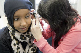 Students working with audiology equipment